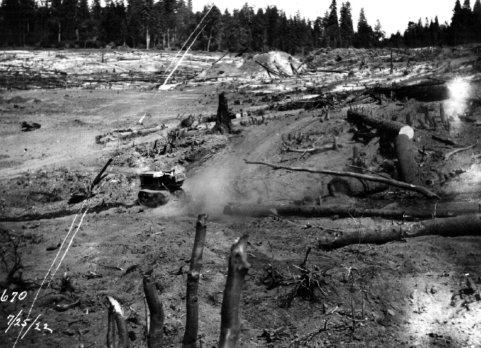 Forebay-Dam-small-tractor-at-site-pulling-logs-for-clearing